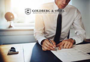 Goldberg & Oriel Attorneys at Law photo of lawyer and paperwork